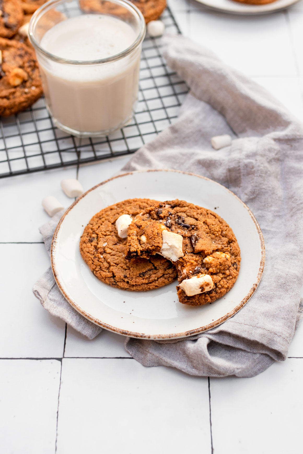 plate with two s'mores cookies and a glass of milk