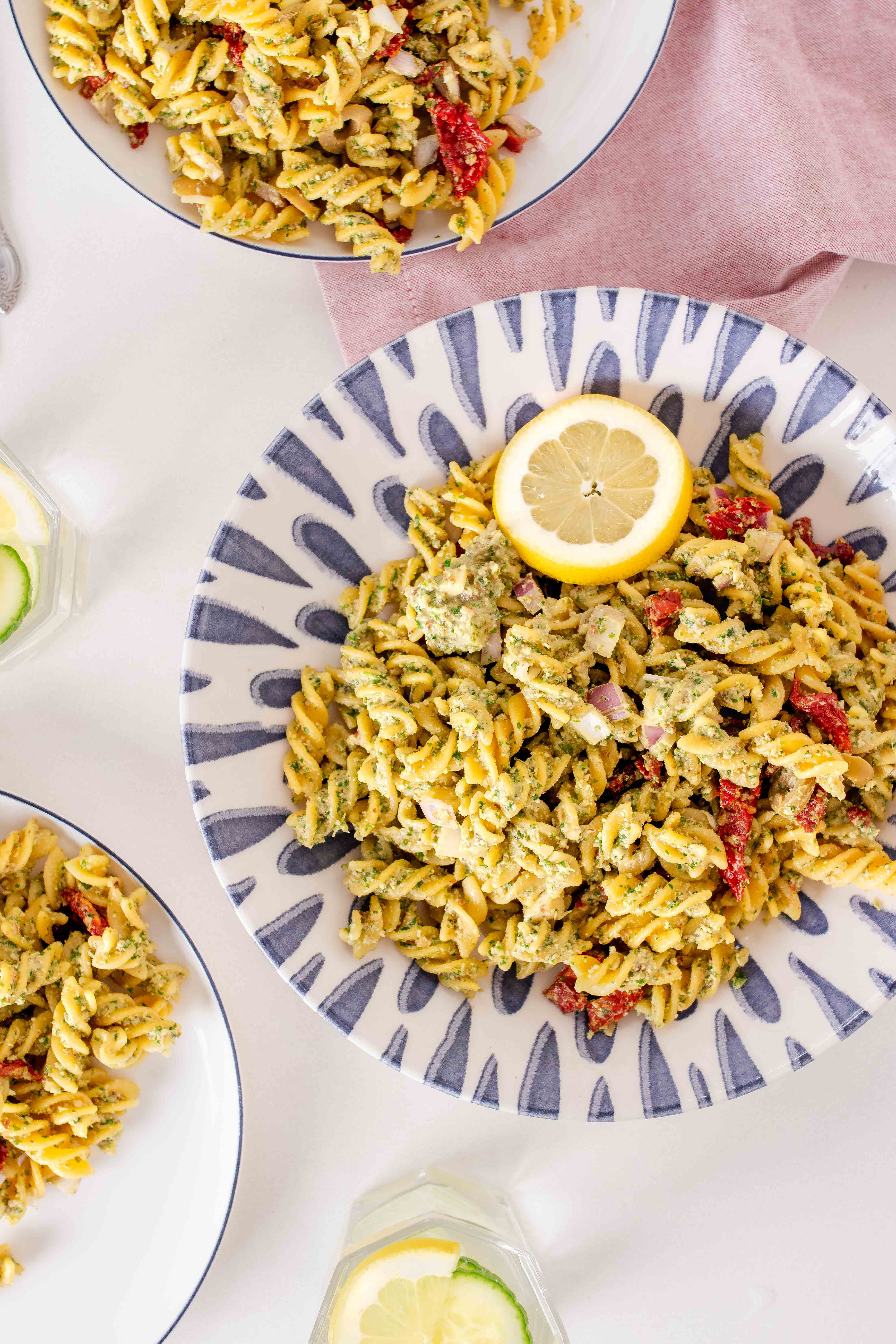 fusilli pasta with pesto, olives, red onion and sundried tomatoes