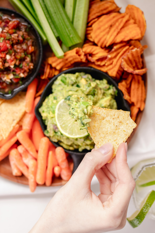 chip dipping into creamy easy guacamole