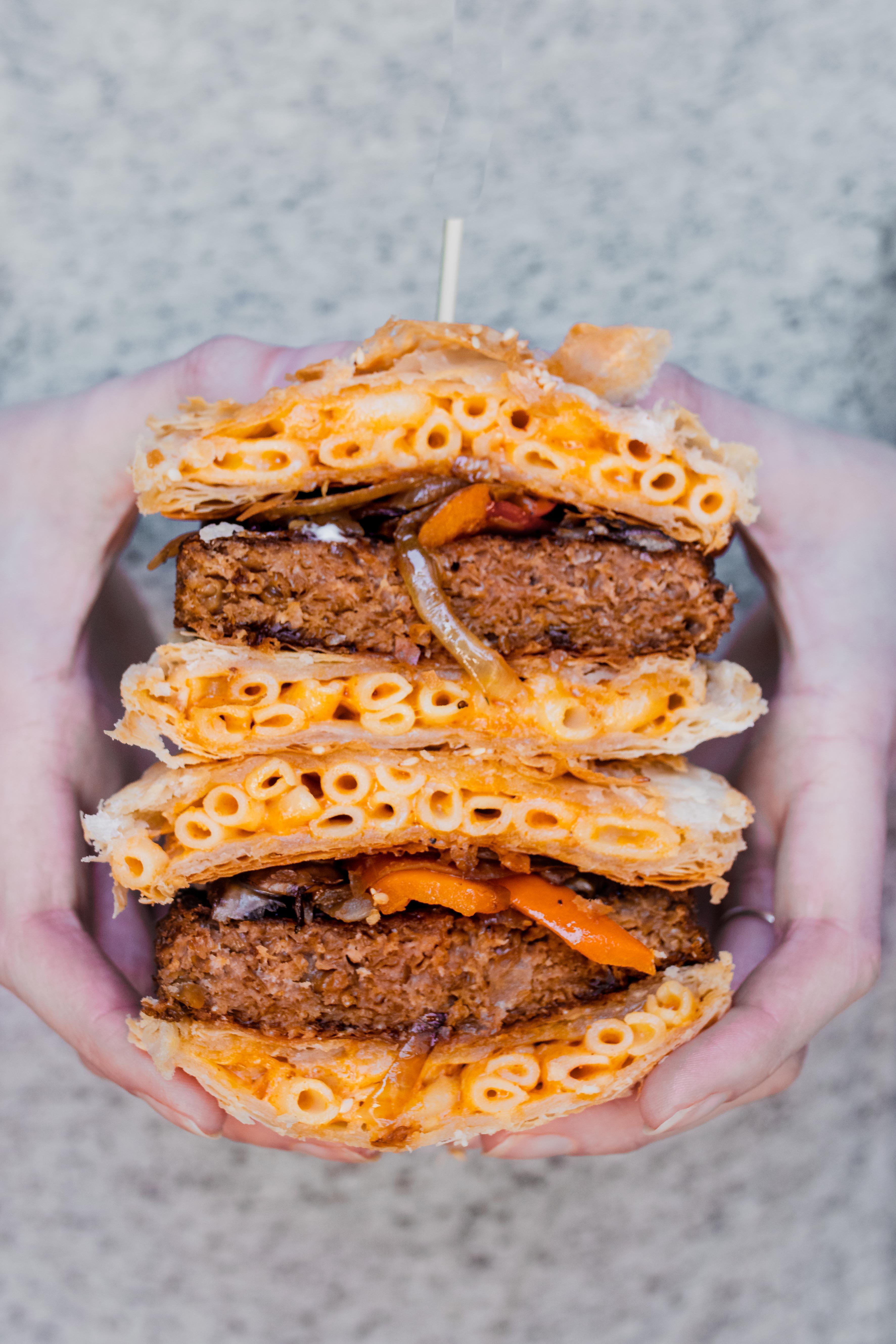buffalo mac n' cheese burger being held