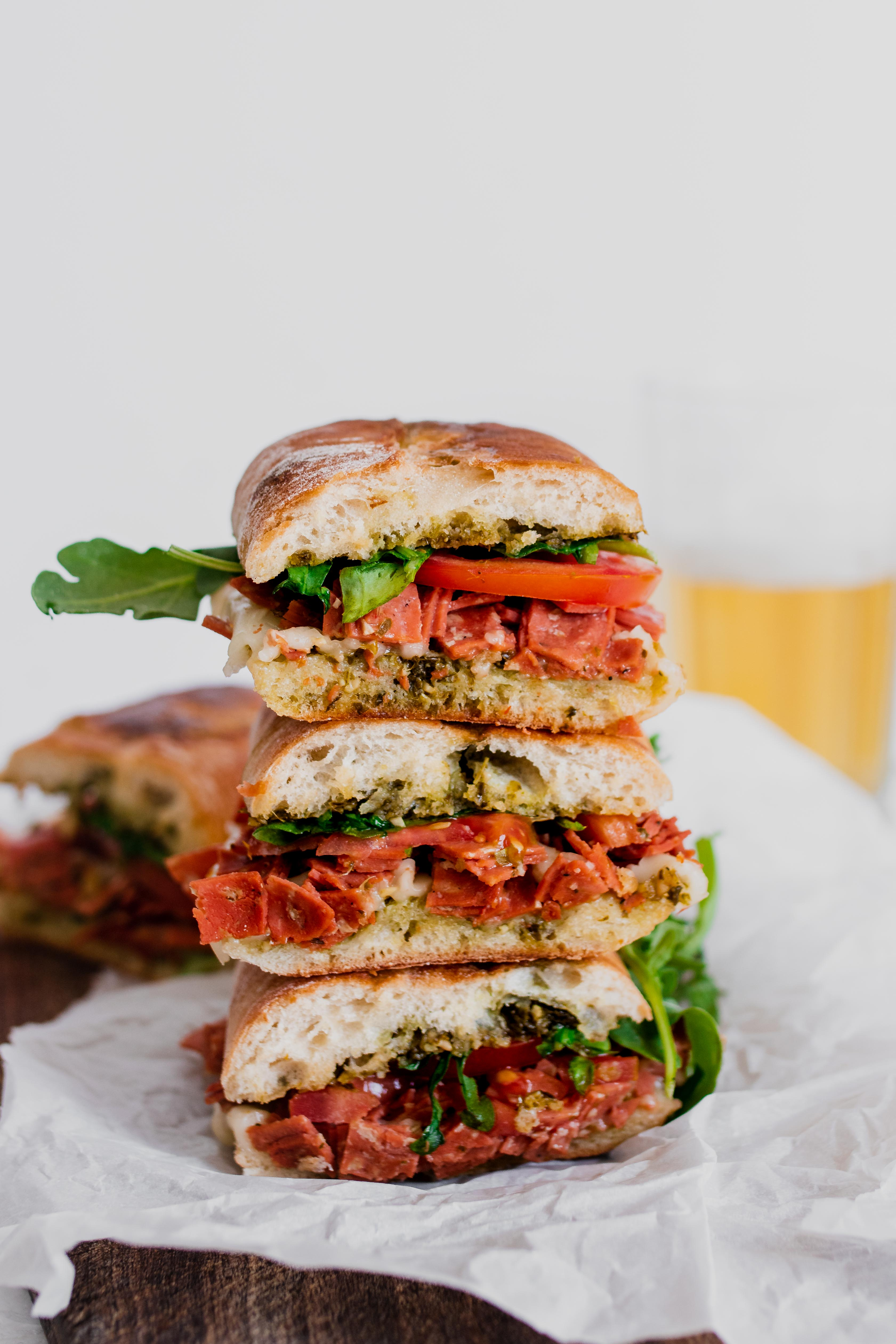 stacked salami pesto sandwich