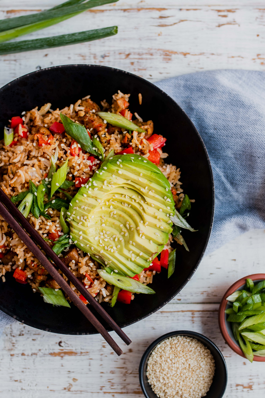 sliced avocado atop breakfast fried rice