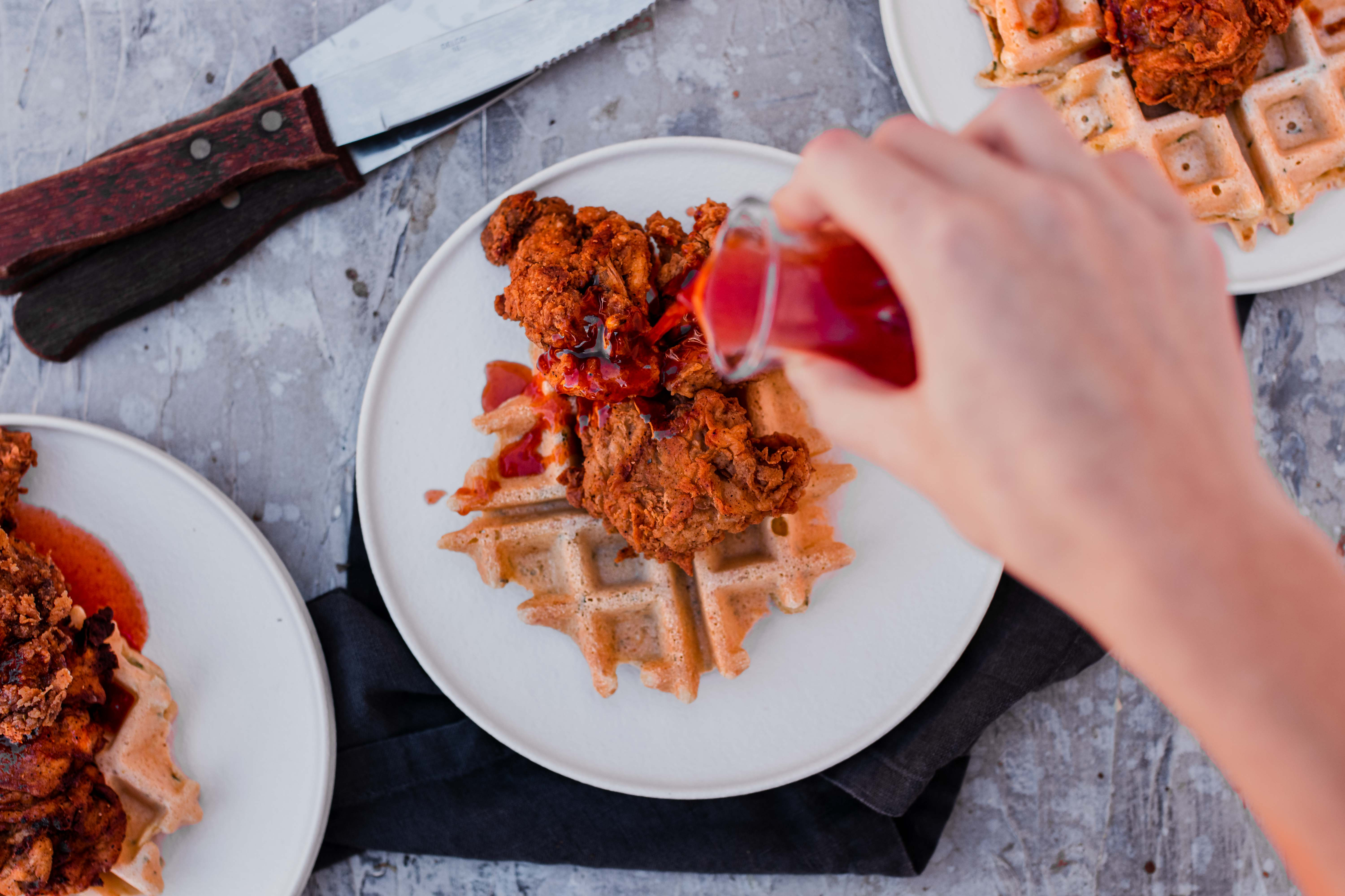 overhead of vegan chicken and waffles