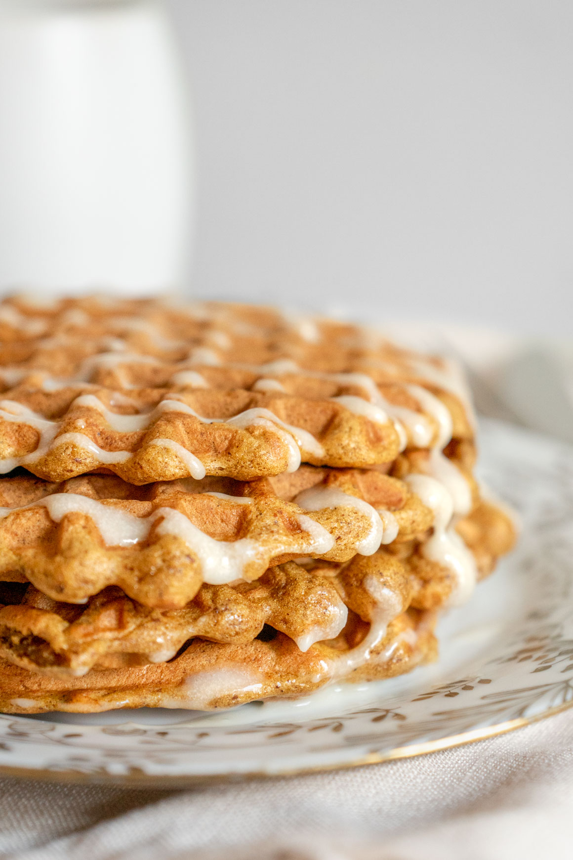 pumpkin spice waffles with maple cream cheese icing