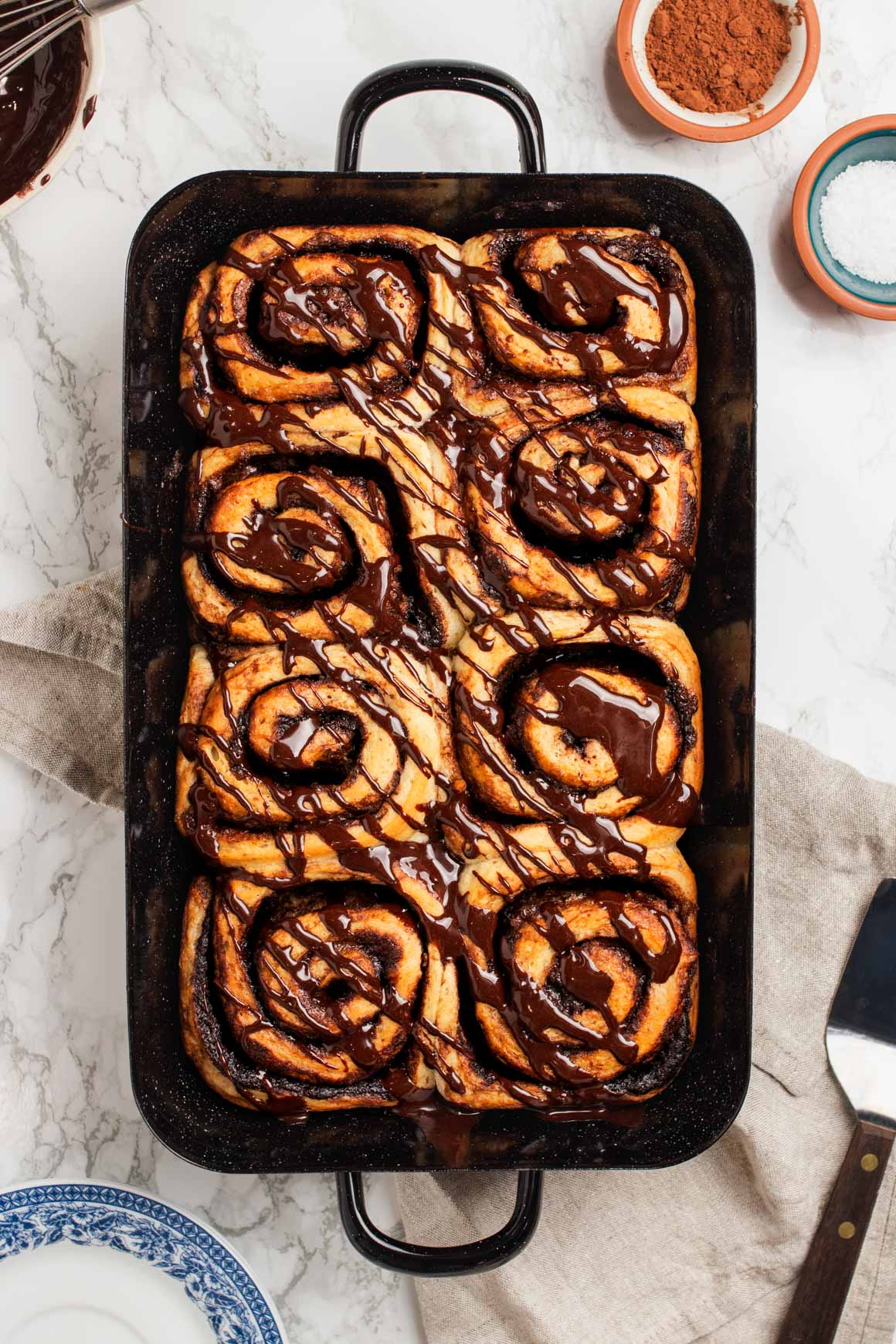 vegan chocolate cinnamon buns with chocolate glaze
