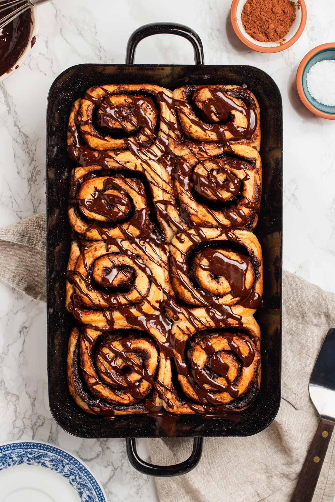 vegan chocolate cinnamon buns with chocolate glaze