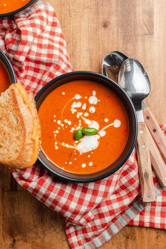creamy vegan tomato soup with grilled cheese