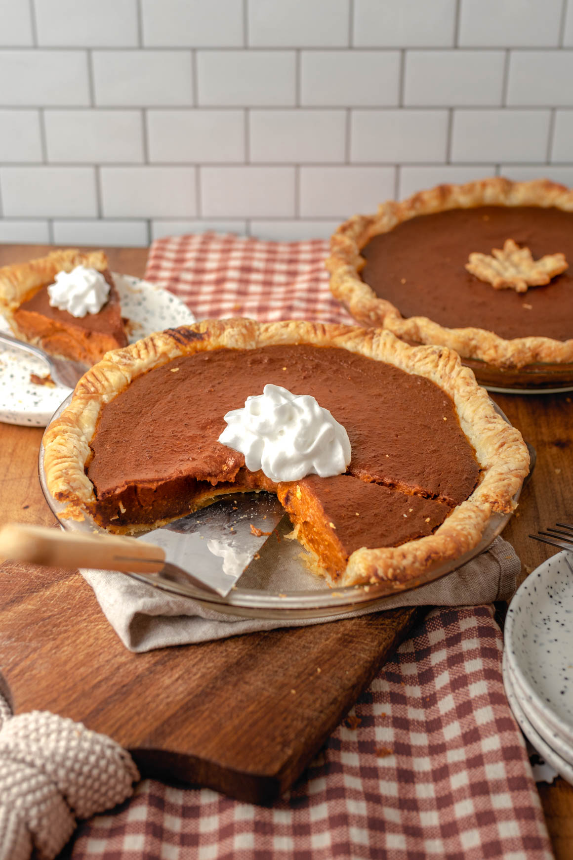 Full pumpkin pie with slices removed
